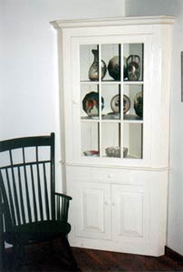 Corner Cupboard with Antique Chair