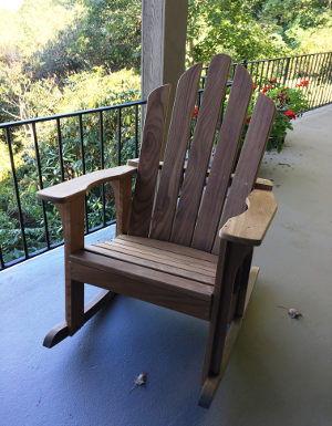 One of a Pair of Teak Porch Rocking Chairs